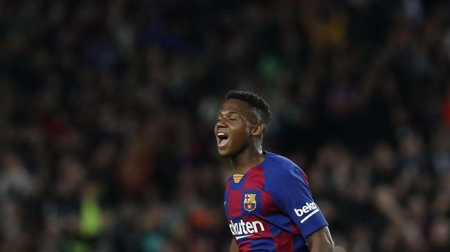 Barcelona's Ansu Fati celebrates after scoring his side's opening goal during a Spanish La Liga soccer match between Barcelona and Levante at the Camp Nou stadium in Barcelona, Spain, Sunday Feb. 2, 2020. (AP Photo/Joan Monfort)