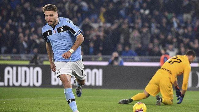Ciro Immobile berhak menyandang gelar top skor Liga Italia setelah Cristiano Ronaldo absen di laga terakhir Juventus.