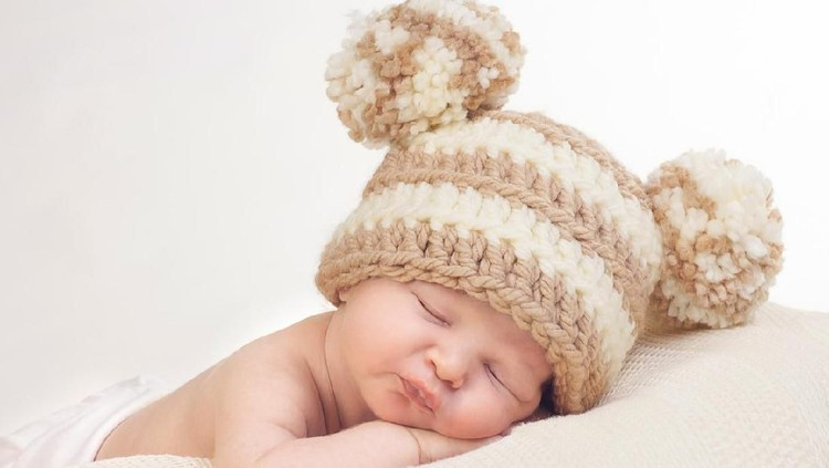 One Month Old Baby Boy Sleeping, wearing a crochet lion cub costume