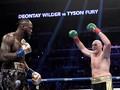 Tyson Fury Menang TKO hingga MU Geser Tottenham
