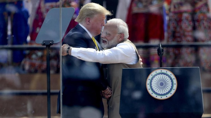 U.S. President Donald Trump and Indian Prime Minister Narendra Modi hug at Sardar Patel Stadium in Ahmedabad, India, Monday, Feb. 24, 2020. India poured on the pageantry with a joyful, colorful welcome for President Donald Trump on Monday that kicked off a whirlwind 36-hour visit meant to reaffirm U.S.-India ties while providing enviable overseas imagery for a president in a re-election year. (AP Photo/Aijaz Rahi)