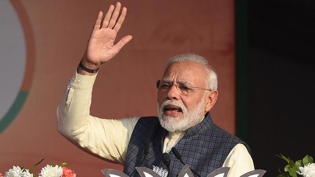 PM India Narendra Modi meminta warga meningkatkan upaya untuk memerangi virus corona setelah mereka dihantam gelombang baru yang parah.