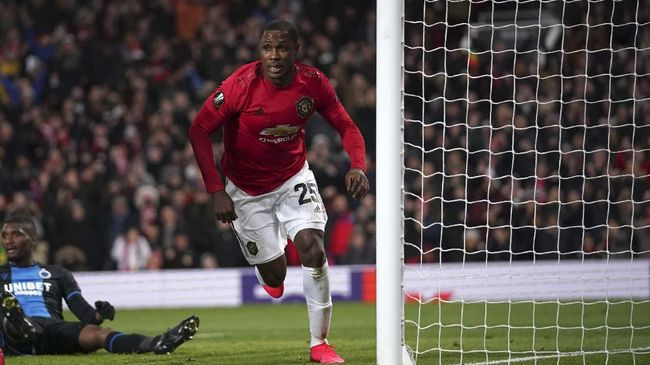Manchester United's Odion Ighalo celebrates after scoring his side's second goal during the round of 32 second leg Europa League soccer match between Manchester United and Brugge at Old Trafford in Manchester, England, Thursday, Feb. 27, 2020. (AP Photo/Dave Thompson)