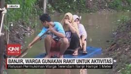VIDEO: Banjir, Warga Gunakan Rakit untuk Aktivitas