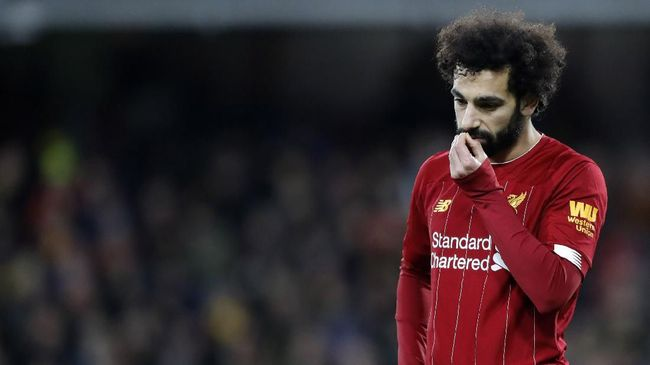 Liverpool's Mohamed Salah leaves the field at the end of the English Premier League soccer match between Watford and Liverpool at Vicarage Road stadium, in Watford, England, Saturday, Feb. 29, 2020. The match finished 3-0. (AP Photo/Alastair Grant)