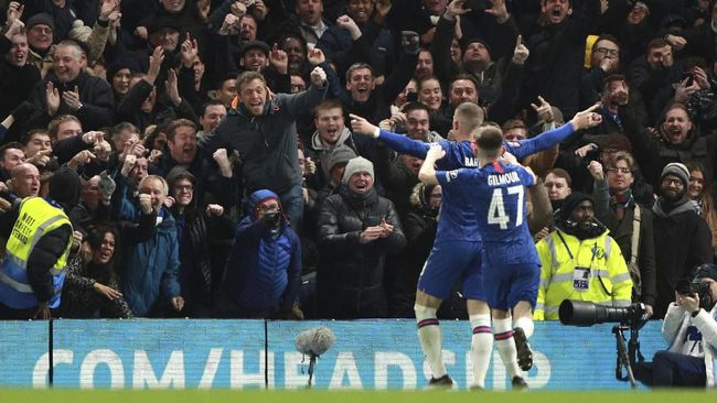 Chelsea's Ross Barkley celebrates after scoring his side's second goal during the English FA Cup fifth round soccer match between Chelsea and Liverpool at Stamford Bridge stadium in London Tuesday, March 3, 2020. (AP Photo/Ian Walton)