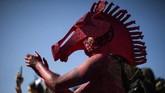 Dalam foto-foto unik pilihan CNNIndonesia.com pekan ini, ada festival holi di India, kawanan sapi di Argentina, dan sepi wisatan di Italia.