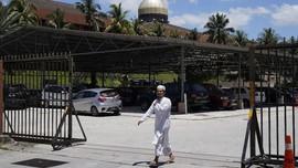 FOTO: Malaysia Tetapkan Lockdown hingga Akhir Maret