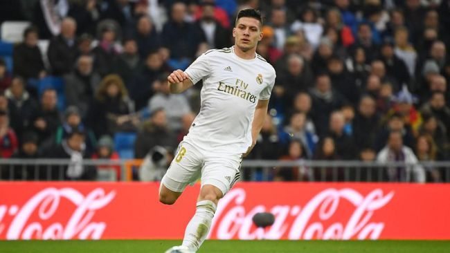 Real Madrid's Serbian forward Luka Jovic runs for the ball during the Spanish league football match between Real Madrid CF and Sevilla FC at the Santiago Bernabeu stadium in Madrid on January 18, 2020. (Photo by GABRIEL BOUYS / AFP)