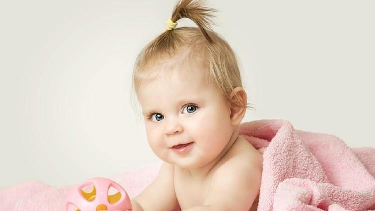 Happy baby girl. Happy little princess.