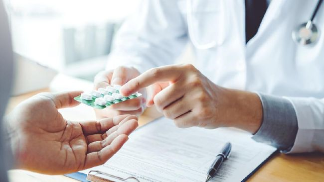 Doctor or physician recommend pills medical prescription to male Patient  hospital and medicine concept