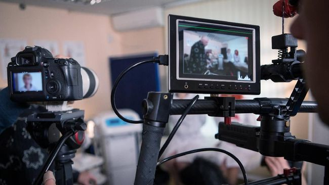 Video cameras on the set, backstage of the movie scene, operator hands