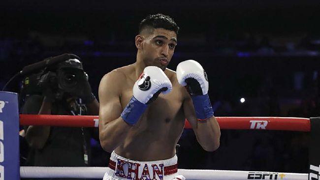 Petinju Inggris, Amir Khan mengaku masih penasaran ingin menghadapi Manny Pacquiao sebelum ia memutuskan pensiun dari dunia tinju.