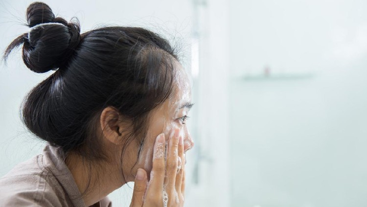 Young Asian Woman Washing Her Face