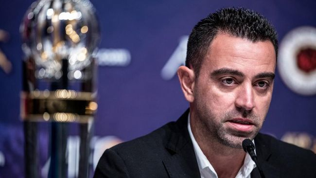 Al Sadd SC Manager Xavier Hernndez Creus, also known as Xavi, speaks to the media after receiving the Asian Football Confederation (AFC) Men's Player of the Year 2019 award in place of absentee Akram Afif, during a press conference after the AFC Annual Awards ceremony in Hong Kong on December 2, 2019. (Photo by Philip FONG / AFP)