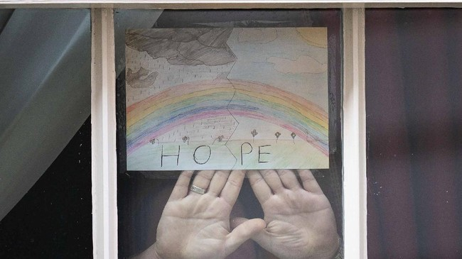 A drawing of a rainbow with the word