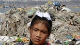 "In this Friday, Feb 21, 2020, photo, environmental activist Licypriya Kangujam, 8, stands at Juhu beach in front of a pile of trash during a cleaning drive in Mumbai, India. Kangujam is among the younger climate activists in the world and, beginning two years ago at age 6, began taking on issues ranging from carbon emissions in her home country to ocean pollution. Insistent that children deserve to be heard on these topics, she's given a TED Talk and attended the United Nations Climate Change Conference. ""I'm strong. I'm brave. I'm intelligent,"" she said. ""(Addressing) climate change is not only for adults, or just for our leaders."" (AP Photo/Rajanish Kakade)"