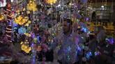 Palestinians buy festive lights in the Zawiya market ahead of the Muslim holy month of Ramadan, in Gaza City, Wednesday, April 22, 2020. (AP Photo/Khalil Hamra)