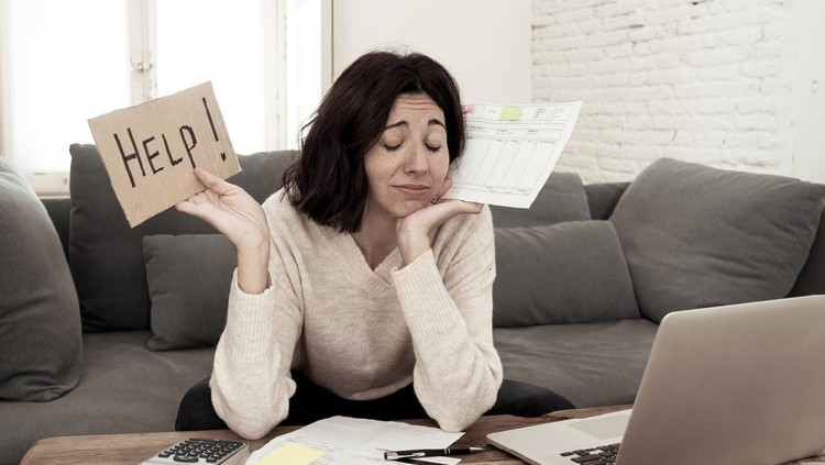Portrait of worried young woman feeling stressed and desperate asking for help in paying bills, debts, tax expenses and accounting home finances with laptop. In online banking and financial problems.