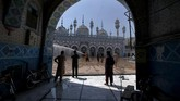Rescue workers spray disinfectant in the courtyard of a mosque in an effort to contain the coronavirus ahead of Muslim fasting month of Ramadan, in Rawalpindi, Pakistan, Tuesday, April 21, 2020. Ramadan begins with the new moon later this week, Muslims all around the world are trying to work out how to maintain the many cherished rituals of Islam's holiest month. (AP Photo/Anjum Naveed)
