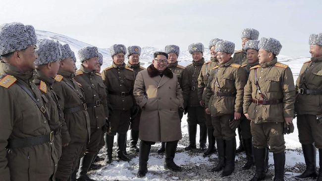 This undated photo provided on Wednesday, Dec. 4, 2019, by the North Korean government shows North Korean leader Kim Jong Un, center, speaks to lieutenants during his visit to Mount Paektu, North Korea. North Korea says leader Kim has taken a second ride on a white horse to a sacred mountain in less than two months. Independent journalists were not given access to cover the event depicted in this image distributed by the North Korean government. The content of this image is as provided and cannot be independently verified. Korean language watermark on image as provided by source reads: