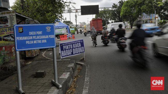 Tidak ada aktivitas berarti disalah satu check point pengawasaan pelaksanaan PSBB di Jakarta. Jumat, 24 April 2020.