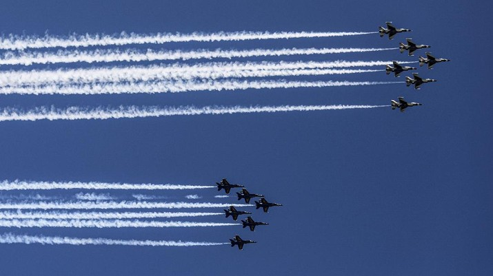 U.S. Navy Blue Angels and U.S. Air Force Thunderbirds flyover New York City skyline, Tuesday April 28, 2020, in New York. The flyover was in salute to first responders in the fight against the COVID-19 pandemic. (AP Photo/Bebeto Matthews)