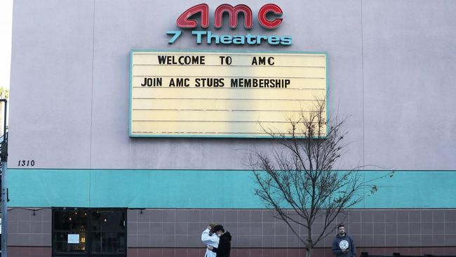 SANTA MONICA, CALIFORNIA - MARCH 17: People walk outside a closed AMC movie theater on March 17, 2020 in Santa Monica, California. AMC Theatres is closing all their theaters nationwide in response to the coronavirus (COVID-19) pandemic.   Mario Tama/Getty Images/AFP