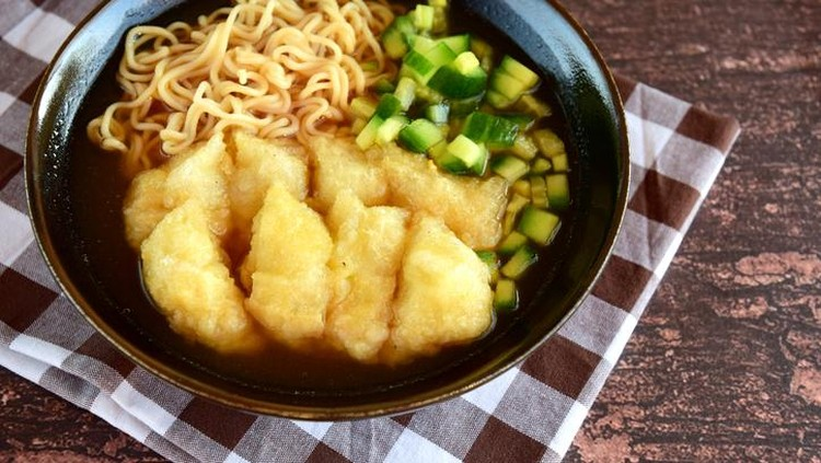 Pempek or mpek-mpek, popular savory fish cake dish from Palembang, South Sumatra, Indonesia. Served in sweet and sour sauce (kuah cuka) accompanied with egg noodle and cucumber