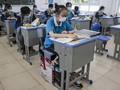 FOTO: Saat Pelajar Wuhan Kembali Bersekolah