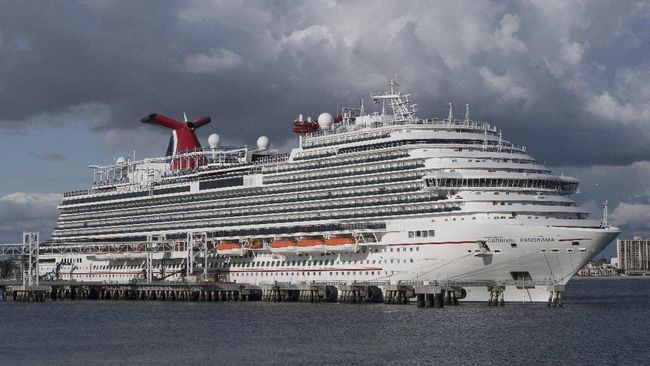 (FILES) In this file photo taken on March 7, 2020 A Carnival Panorama cruise ship is seen docked in Long Beach, California on, as passengers await onboard for the results of a COVID-19 (Coronavirus) test given to an ill passenger. - Carnival Cruise Line announced on May 4, 2020 that it will resume limited operations from Florida and Texas on August 1 after halting cruises because of the coronavirus pandemic which left some passengers trapped on its ships for weeks. (Photo by Mark RALSTON / AFP)