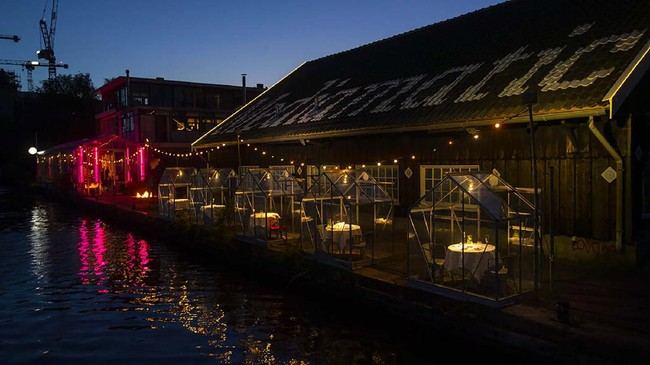 Small glasshouses are seen at Mediamatic restaurant after a try-out of a setup which respects social distancing between clients abiding by government directives to combat the spread of the COVID-19 coronavirus in Amsterdam, Netherlands, Tuesday, May 5, 2020. (AP Photo/Peter Dejong)