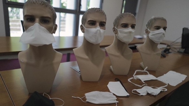 Samples of public masks are displayed at the French General Armament Directorate, DGA, specialized in research of Bacteriological Chemical and Nuclear military protection gear, in their lab at Vert Le Petit, south of Paris, Wednesday, May 6, 2020 as a nationwide confinement continues to counter the COVID-19. The DGA is responsible for giving official stamps of approval for masks being piloted by French companies, vital equipment that will help prevent dissemination and transmission of coronavirus. The DGA approval is not legally obligatory for masks to be sold on French soil. (AP Photo/Francois Mori)
