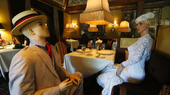 Mannequins provide social distancing at the Inn at Little Washington as they prepare to reopen their restaurant Thursday May 14, 2020, in Washington, Va. The manager say that every other table will have mannequins for social distance guidance when, according to state guidelines, the 5-star restaurant will be allowed reopen on May 29th. (AP Photo/Steve Helber)
