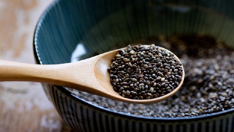 Nutritious chia seeds on a wooden spoon, superfood