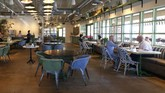 With social distancing guidelines in place, Flower Child restaurant, part of the Fox Restaurant Concepts' Phoenix-based eateries, opens for dine-in service, expanding from their takeout option, as Arizona slowly relaxes restrictions due to the coronavirus Monday, May 11, 2020, in Phoenix. (AP Photo/Ross D. Franklin)