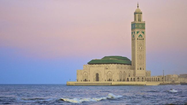 Sunset image of the King Hassan II Mosque on the Atlantic Coast of Casablanca in Morocco