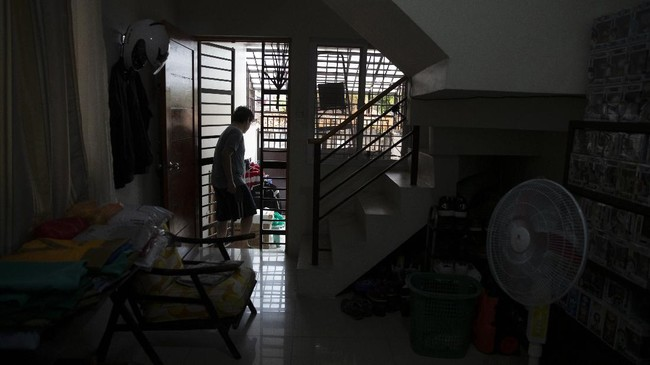 In this May 9, 202, photo, anesthesiologist Manuel Sotelo III goes out to check his laundry as he lives alone at San Juan in Manila, Philippines. Sotelo was tested positive for the COVID-19 disease last month and is now cleared of the virus. Like many health workers, he now lives away from family for fear that he might bring home the virus as he goes back to the frontlines to take care of COVID-19 patients. (AP Photo/Aaron Favila)