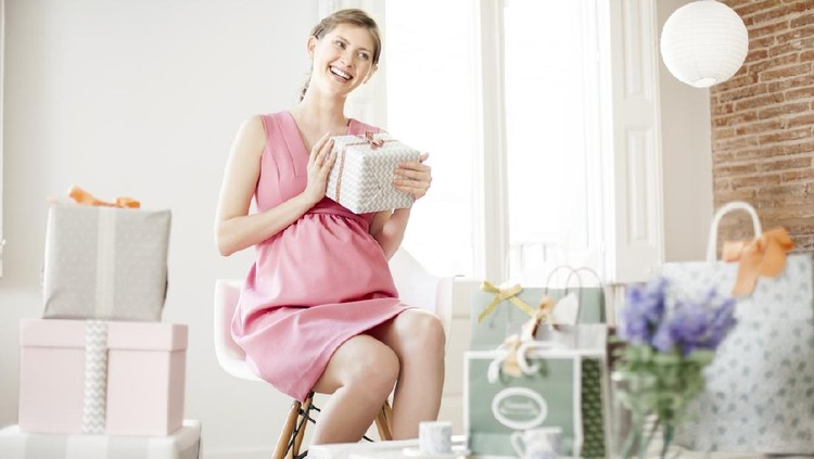 Pregnant woman welcoming gussets to her baby shower party