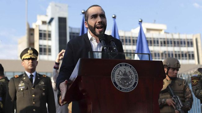 El Salvador's President Nayib Bukele, accompanied by members of the armed forces, speaks to supporters outside Congress in San Salvador, El Salvador. Bukele has imposed some of the region's toughest measures against the new coronavirus and a growing number of human rights advocates at home and abroad complain the 38-year-old leader has used the emergency to seize near-dictatorial powers. (AP Photo/Salvador Melendez, File)