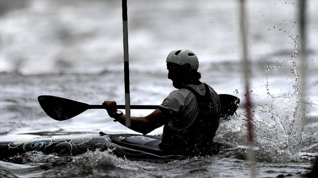 Tyler Uthus Westfall, a kayak athlete on Team USA kayak team, works out on the Potomac River during a training session, Friday, May 22, 2020, in Brookmont, Md. Westfall's summer plans to participate in the Tokyo 2020 Olympics have been pushed back for a year after the games were postponed because of the coronavirus outbreak. (AP Photo/Julio Cortez)