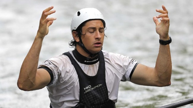 Tyler Uthus Westfall, a kayak athlete on the Team USA kayak team, reacts after his coach Silvan Poberaj told him his timing on a practice run on the Potomac River during a training session, Friday, May 22, 2020, in Brookmont, Md. Westfall's summer plans to participate in the Tokyo 2020 Olympics have been pushed back for a year after the games were postponed because of the coronavirus outbreak. (AP Photo/Julio Cortez)
