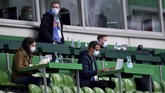Journalists wearing face masks at the tribune prior to the German Bundesliga soccer match between Werder Bremen and Bayer Leverkusen 04 in Bremen, Germany, Monday, May 18, 2020. The German Bundesliga becomes the world's first major soccer league to resume after a two-month suspension because of the coronavirus pandemic. (AP Photo/Stuart Franklin, Pool)