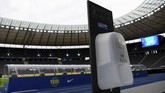 A hand sanitizer is seen inside the stadium before the the German Bundesliga soccer match between Hertha BSC Berlin and 1. FC Union Berlin in Berlin, Germany, Friday, May 22, 2020. The German Bundesliga is the world's first major soccer league to resume after a two-month suspension because of the coronavirus pandemic. (Stuart Franklin/Pool Photo via AP)