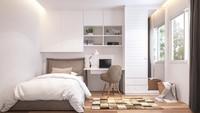 Dengan ruang terbatas di rumah minimalis, Bunda bisa menyisakan satu space untuk meja kerja di antara kabinet dan lemari. (Foto: iStock)