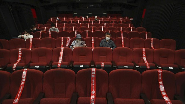 CORRECTS SLUG: Red tape blocks off some seats in an attempt to promote social distancing at a movie theater which reopened on May 22,  in Kyoto, western Japan, Saturday, May 23, 2020. Japan has lifted the coronavirus state of emergency in Osaka and the two neighboring prefectures of Kyoto and Hyogo while keeping the measure in place in the Tokyo region and the northernmost island of Hokkaido. (Kyodo News via AP)