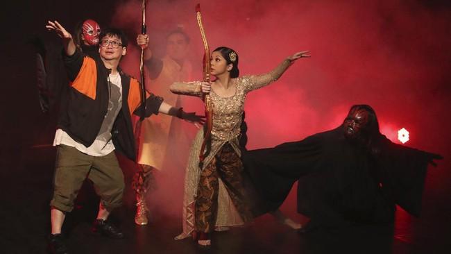 Indonesian choreographer Rusdy Rukmarata, left, directs dancers Nala Amyrtha, center, and Siswanto