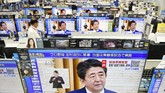 TV sets show a news conference by Japan's Prime Minister Shinzo Abe, at an electric store in Urayasu, near Tokyo Monday, May 25, 2020. Abe lifted a coronavirus state of emergency in Tokyo and four other remaining areas on Monday, ending the restrictions nationwide as businesses begin to reopen. (Kyodo News via AP)