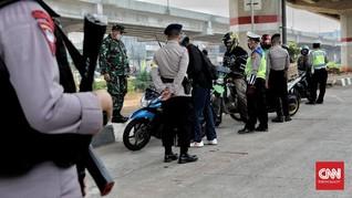 Titik Pemeriksaan Arus Balik Dikawal Polisi Bersenjata