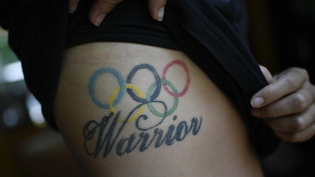 Venezuelan Olympic medalist Stefany Hernandez, a BMX racing cyclist, shows her Olympic rings tattoo, a reference to her competing at the 2016 Rio Summer Olympics, in Caracas, Venezuela, Monday, May 25, 2020. Despite a quarantine to curb the spread of COVID-19, Hernandez trains three times a week in hopes of qualifying for the 2021 Tokyo Summer Olympics. (AP Photo/Matias Delacroix)